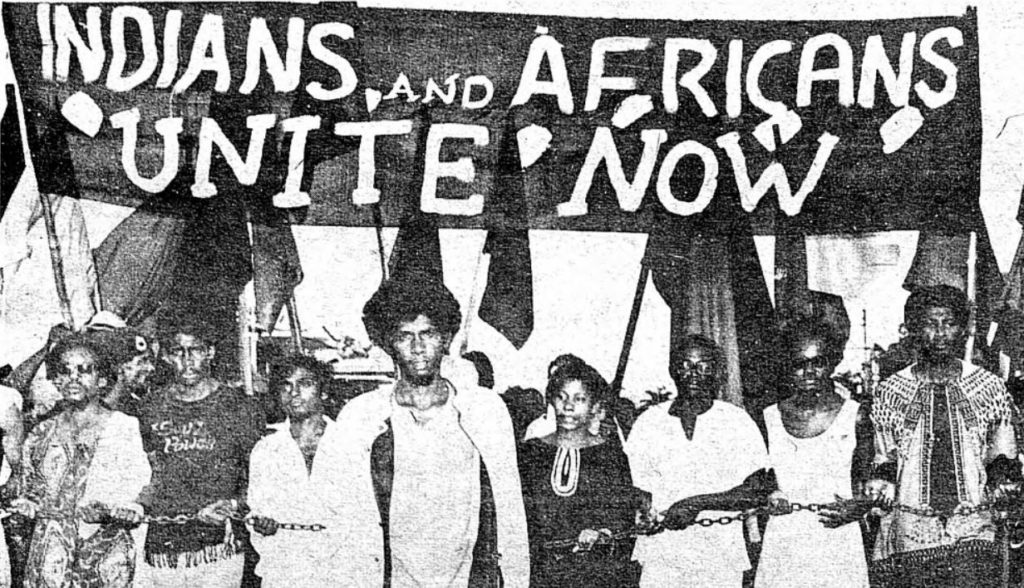 """Africans and Indians Unite Now"" banner raised during the Black Power Movement March to Caroni"